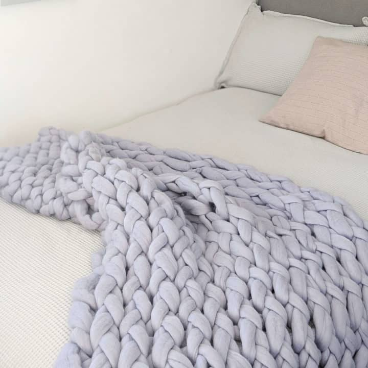 blue grey chunky knit blanket on bed