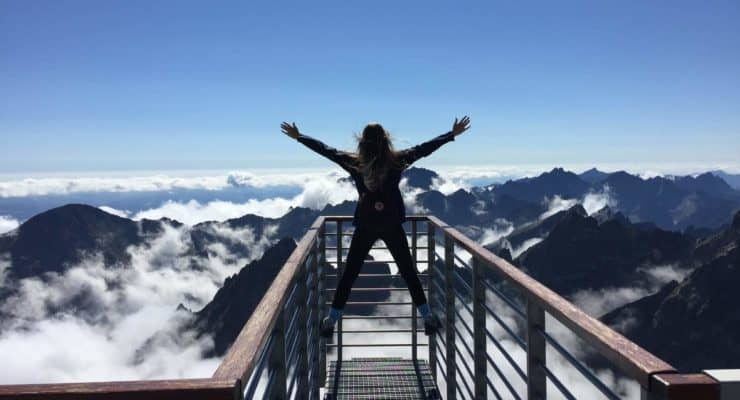self-improvement tips: women standing over mountains