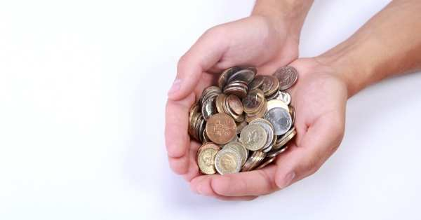 How to be frugal: hands holding change
