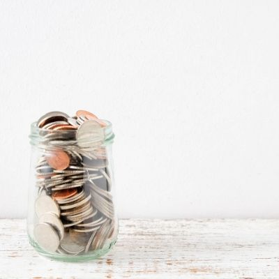 simplify your life and live more frugally. change in a glass jar.