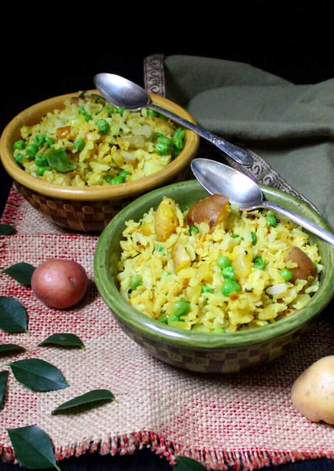 Flattened rice with onions, potatoes and peas, or Kande Pohe. An Indian breakfast classic.